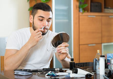 Guy remove hair from his nose Stock Photos