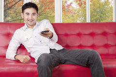 Guy replace tv channel with smartphone Royalty Free Stock Photos