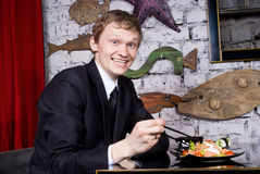 Guy in the restaurant dining Royalty Free Stock Image