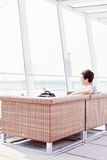 Guy resting in airport lounge Royalty Free Stock Photos