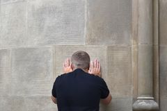 The guy with reverence touches the sacred wall royalty free stock image