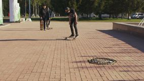 Guy rides and falls down from skateboard on square stock video footage