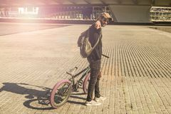 Guy riding a bmx bike with a positive attitude. And pointing to the camera stock images