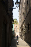 Guy riding a bycicle in Barcelona, Spain Royalty Free Stock Photo