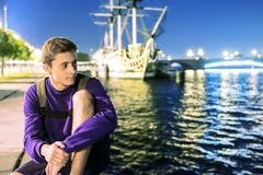The guy by the river looks into the distance. Sailboat at night on the river. Russia. Night. Ancient ship on the river. royalty free stock photo