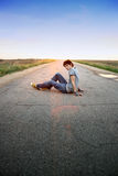 Guy  on the road. Guy  is sitting on the road Stock Photos