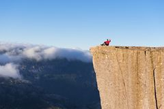 Guy on the Rock Preikestolen, Norway Stock Photos