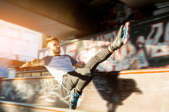 Guy on rollerblades doing trick. Stock Images