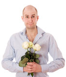 Guy with roses. Picture of a young male holding a flower, isolated on white Stock Photo