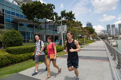 Guy running along the waterfront Marina Bay in Singapore Stock Images