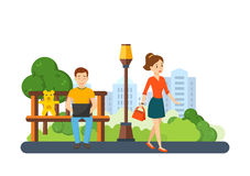Guy running remotely on freelance, next girl go with handbag. Stock Image