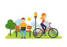 Guy running remotely on freelance, next the girl rides bicycle. Royalty Free Stock Images