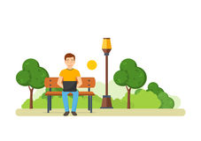 The guy running remotely on a freelance in the park. Royalty Free Stock Images
