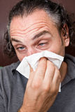 Guy with a runny nose Royalty Free Stock Photo