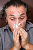 Guy with a runny nose Stock Photos