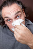 Guy with a runny nose Royalty Free Stock Photography
