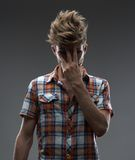 Guy that's done, close the face  his hand. Guy that's done, close the face with his hand Royalty Free Stock Images