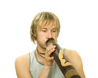 Guy's playing  didgeridoo Stock Image