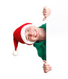 Guy with santa hat and sign Stock Photo