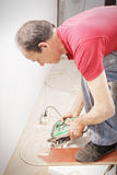 Guy sawing off plank Royalty Free Stock Photography