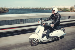 Guy on scooter Stock Photography