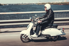 Guy on scooter Royalty Free Stock Images