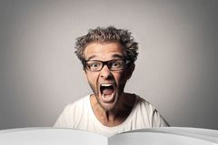 Guy is screaming. Guy in white t-shirt very much screaming Royalty Free Stock Image