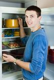 Guy searching for something in refrigerator Royalty Free Stock Photo