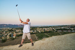 Guy with selfie stick Stock Images