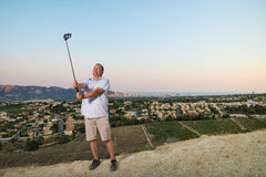 Guy with selfie stick Royalty Free Stock Photography