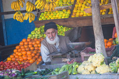 Guy selling fruit in market Stock Image