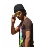 Young Man Shades. Young man wearing shades and a black cap Royalty Free Stock Images
