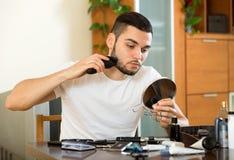 Guy shaving face Royalty Free Stock Image