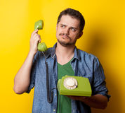 Guy in shirt with green dial phone Stock Photo