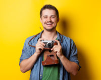 Guy in shirt with vintage camera Royalty Free Stock Photography