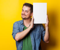 Guy in shirt with white board Royalty Free Stock Photography