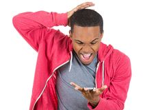 Guy shocked and surprised at what he sees on his cellphone Stock Photography