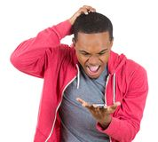Guy shocked and surprised at what he sees on his cellphone Royalty Free Stock Image