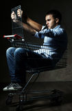 Guy in shopping cart Royalty Free Stock Photography