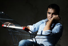 Guy in shopping cart Royalty Free Stock Images