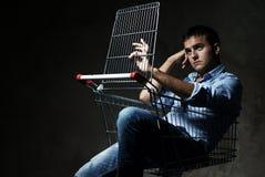 Guy in shopping cart Stock Photos