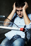 Guy in shopping cart Royalty Free Stock Photo