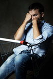 Guy in shopping cart Stock Image
