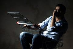Guy in shopping cart Royalty Free Stock Image