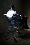 Guy in shopping cart Stock Photos