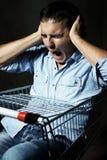 Guy in shopping cart screaming Royalty Free Stock Photos