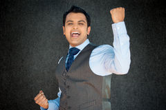 Guy shouting with joy, fists in air. Closeup portrait, handsome excited, energetic, happy, smiling student man winning, arms, fists pumped, celebrating success Stock Photo