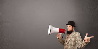 Guy shouting into megaphone Royalty Free Stock Image