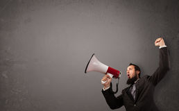 Guy shouting into megaphone on copy space Stock Images