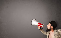 Guy shouting into megaphone Stock Image